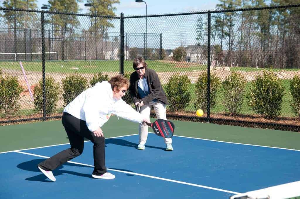 Women with pickleball paddle
